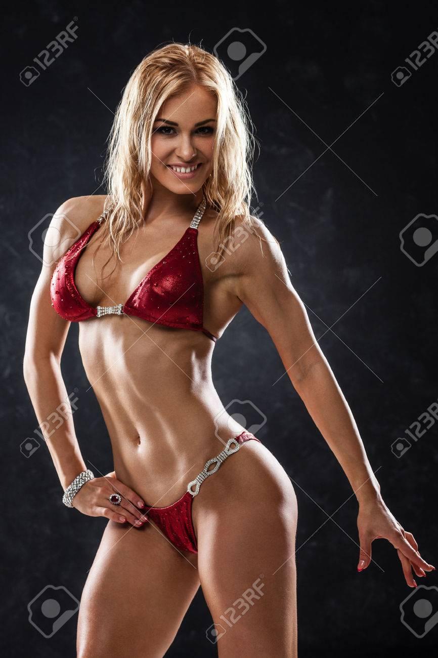 Muscle in red bikini