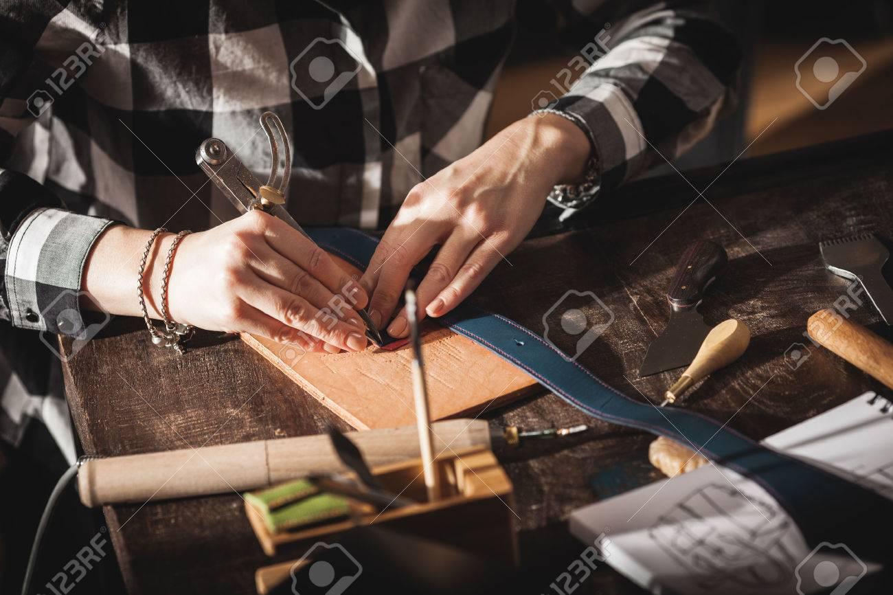Leather handbag craftsman at work in a workshop - 63492873