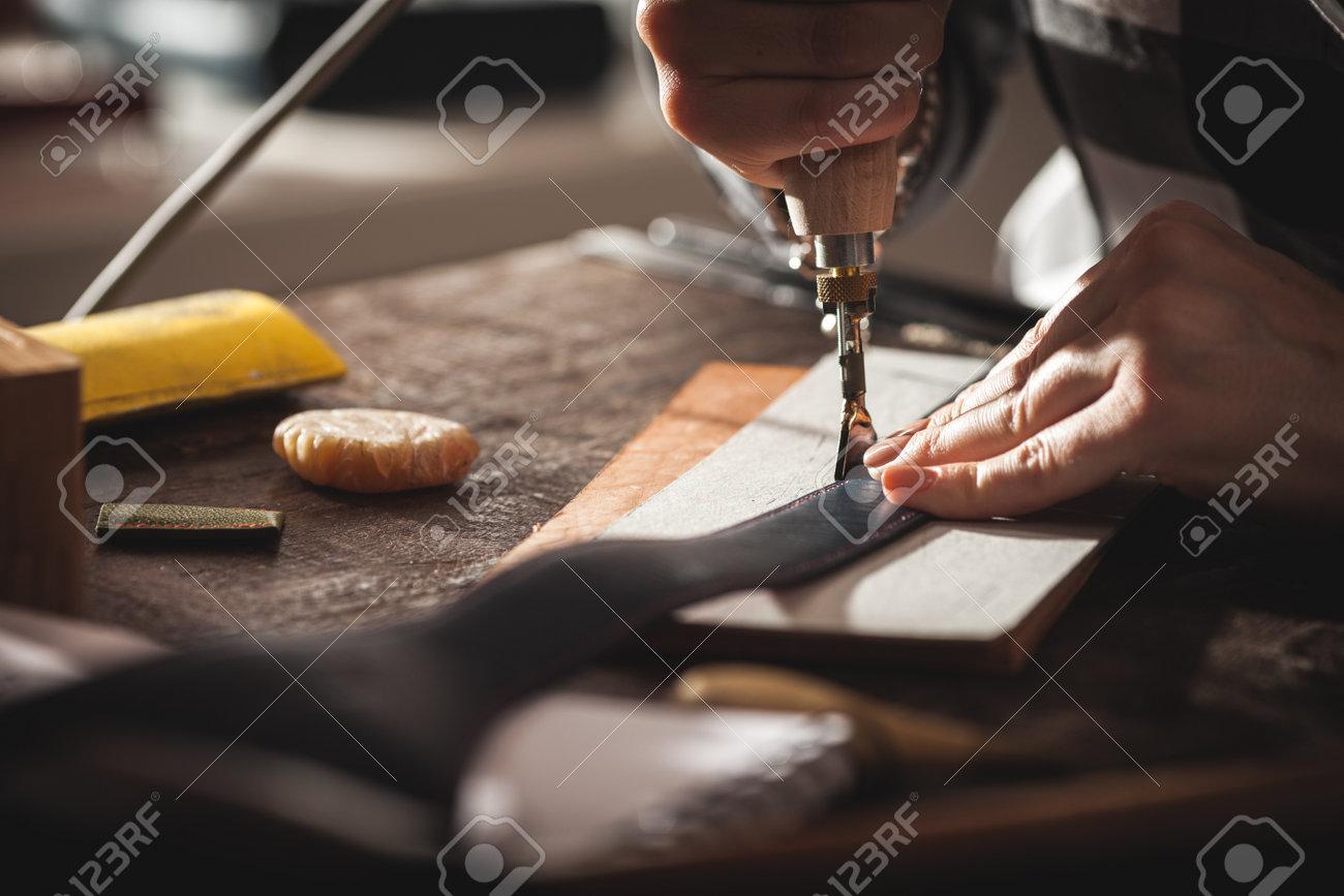 Leather handbag craftsman at work in a vintage workshop. Small business concept. - 166035446