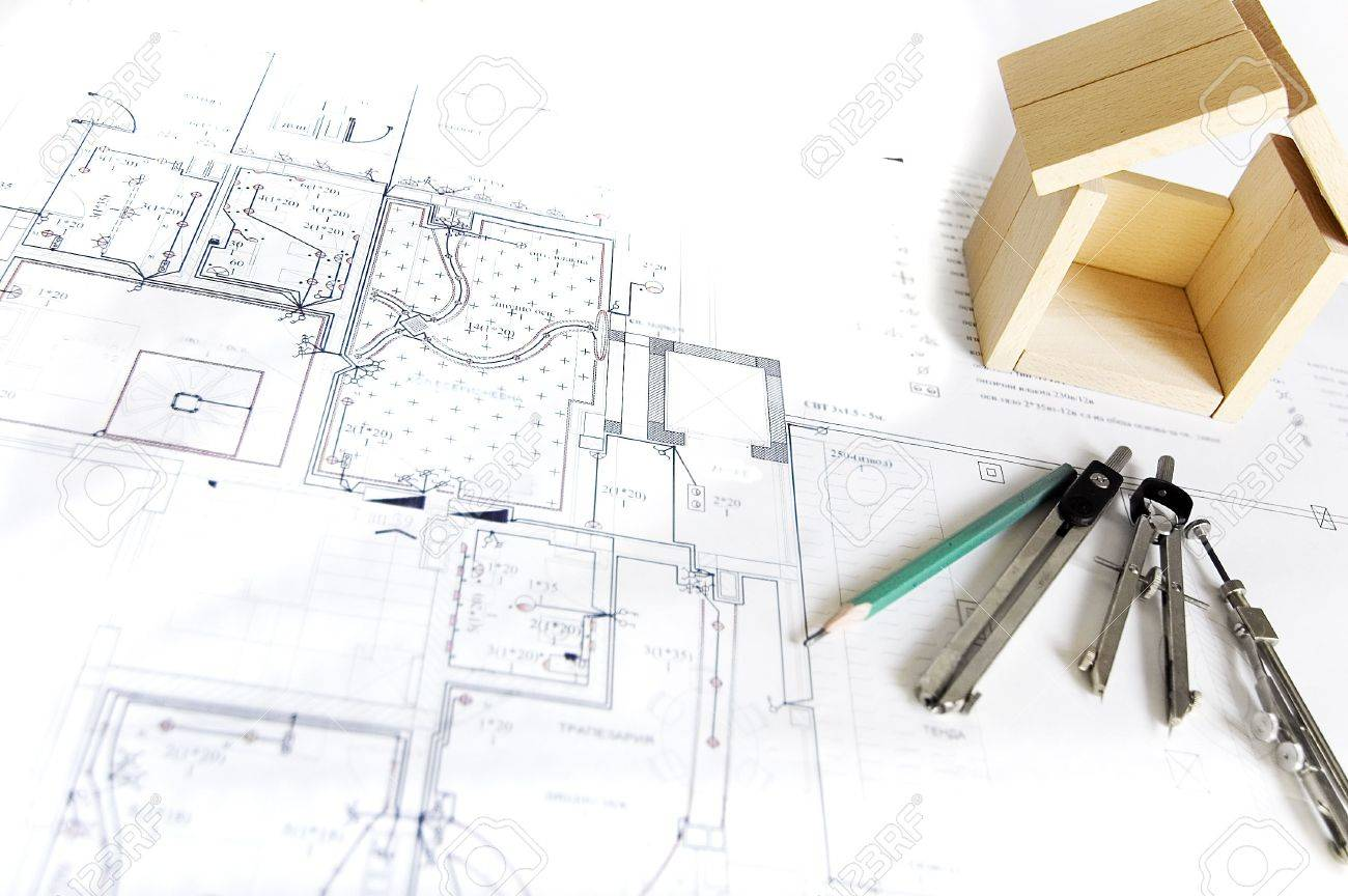 blueprint wooden model of house and drawing tools stock photo