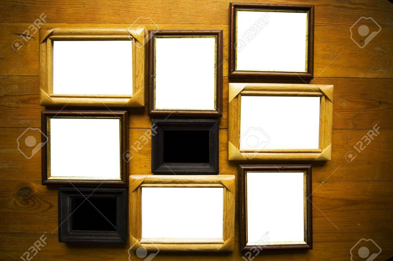 empty picture frames on wooden wall Stock Photo - 3089915