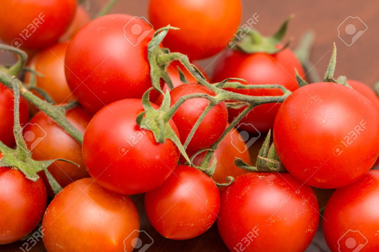 The Bunch Of Tomatoes On The Kitchen Table Ready For Preparing Stock Photo Picture And Royalty Free Image Image 102076548