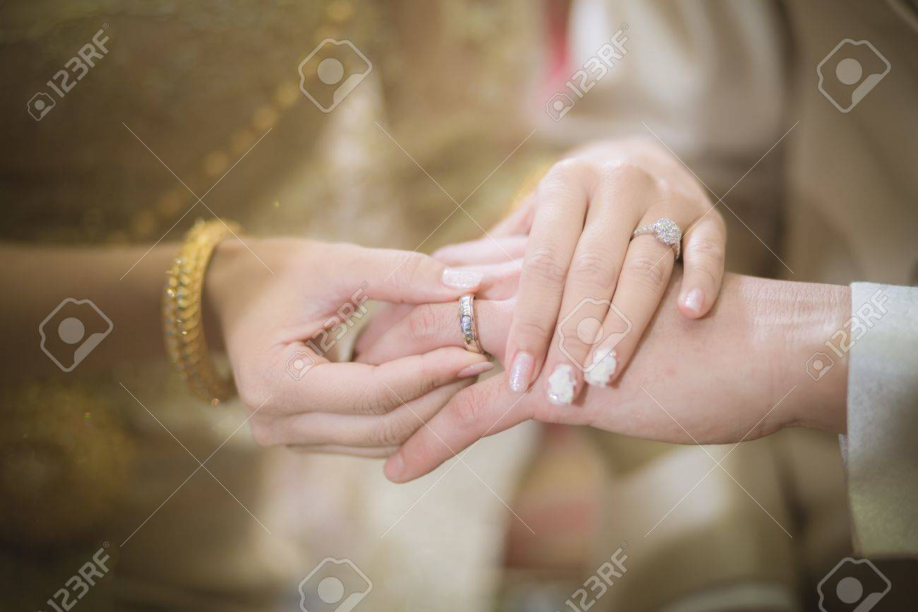 Thai Groom Wearing Wedding Ring For His Bride Stock Photo Picture