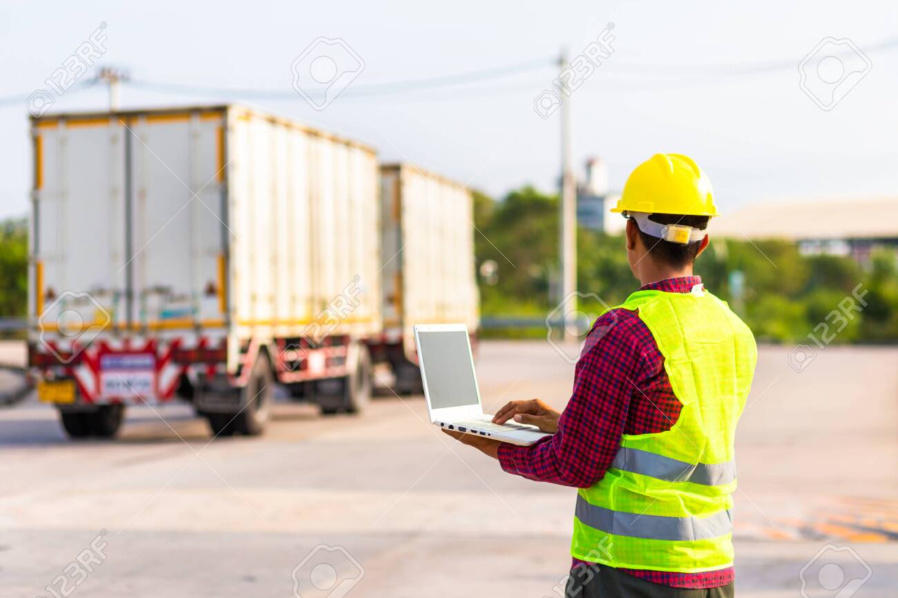 Foreman use computer for test and checking vehicle at industry. Working concept. - 120244199
