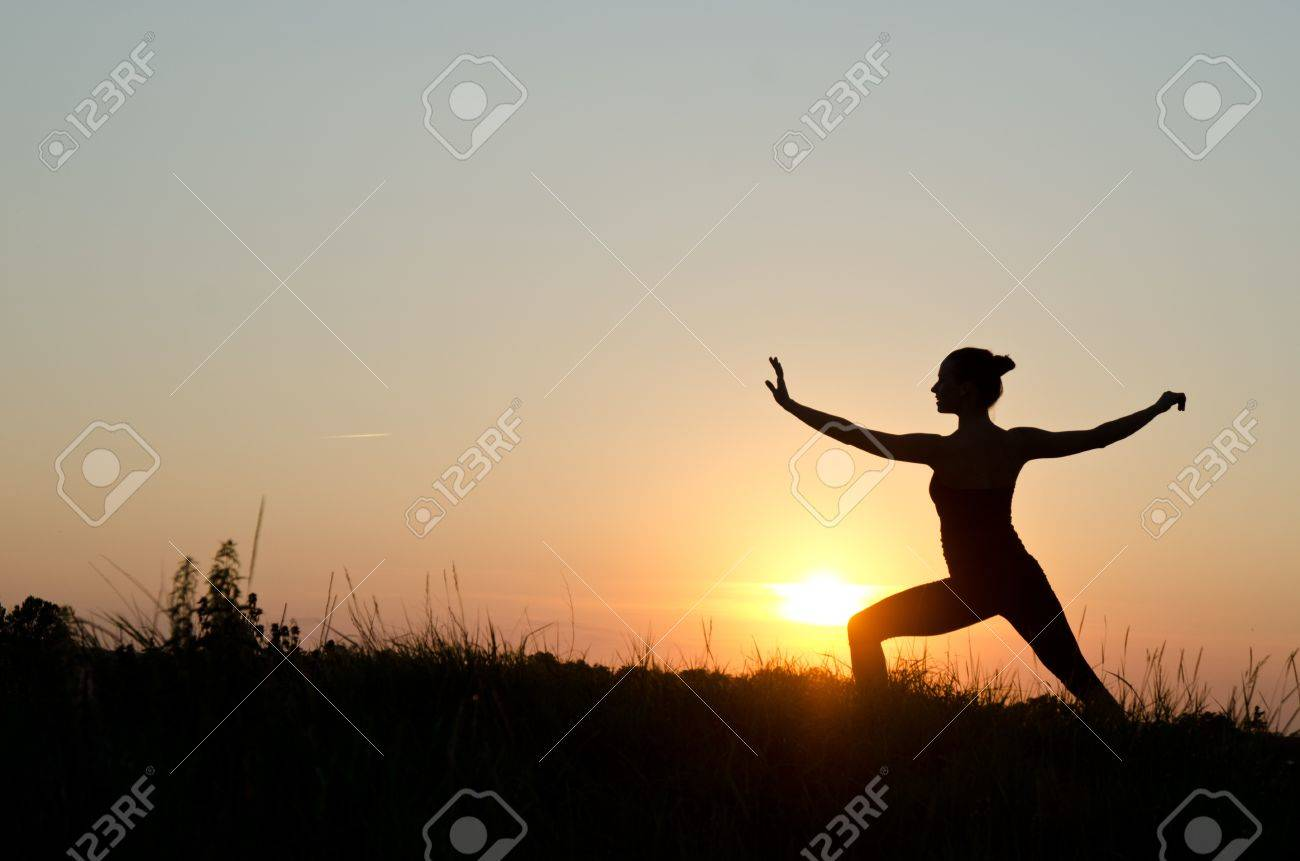 Woman Praticing Tai Chi Chuan At Sunset. Stock Photo, Picture And ...