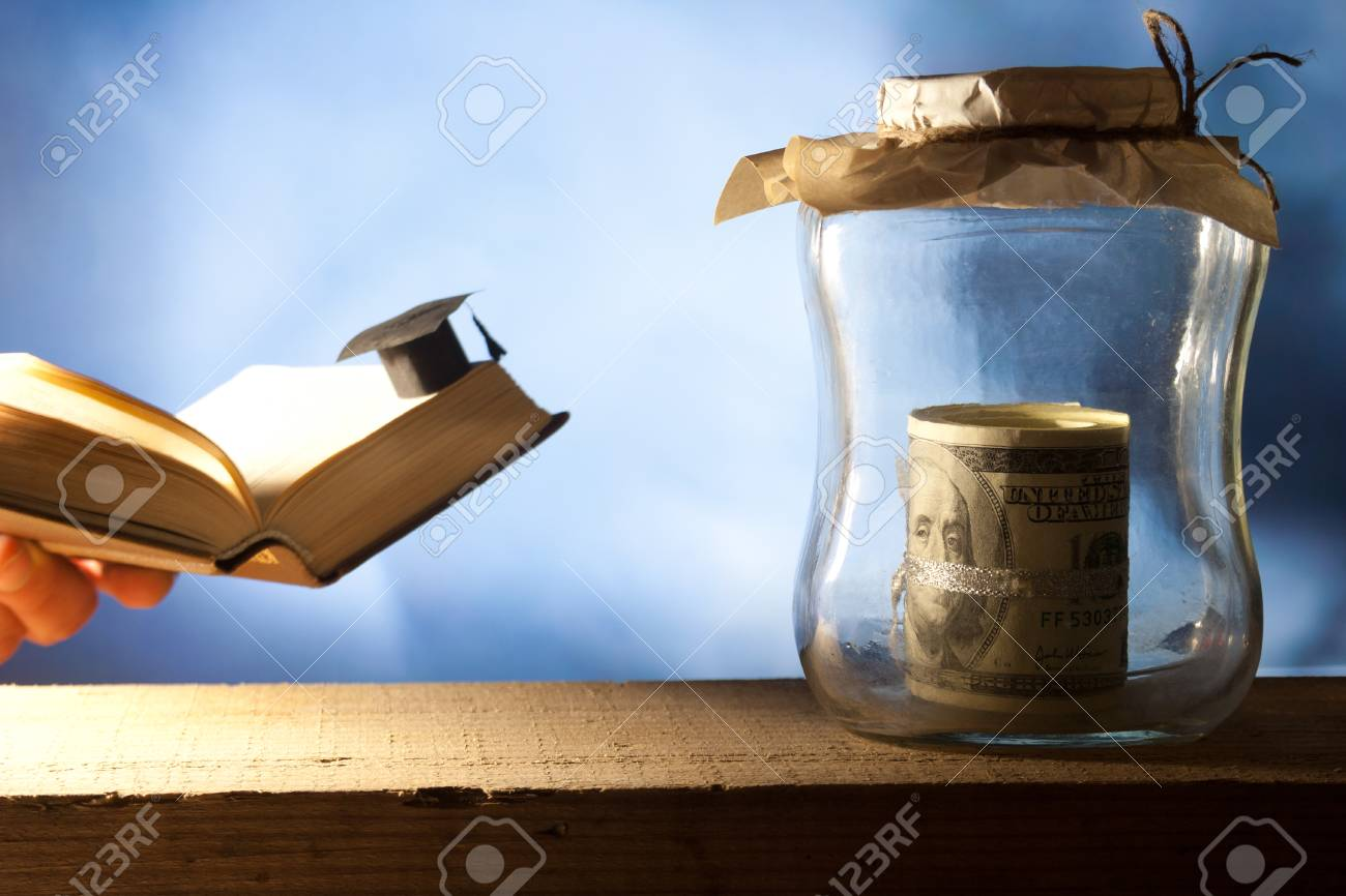 Jar with money, college graduation cap and open book. Stock Photo - 22582547