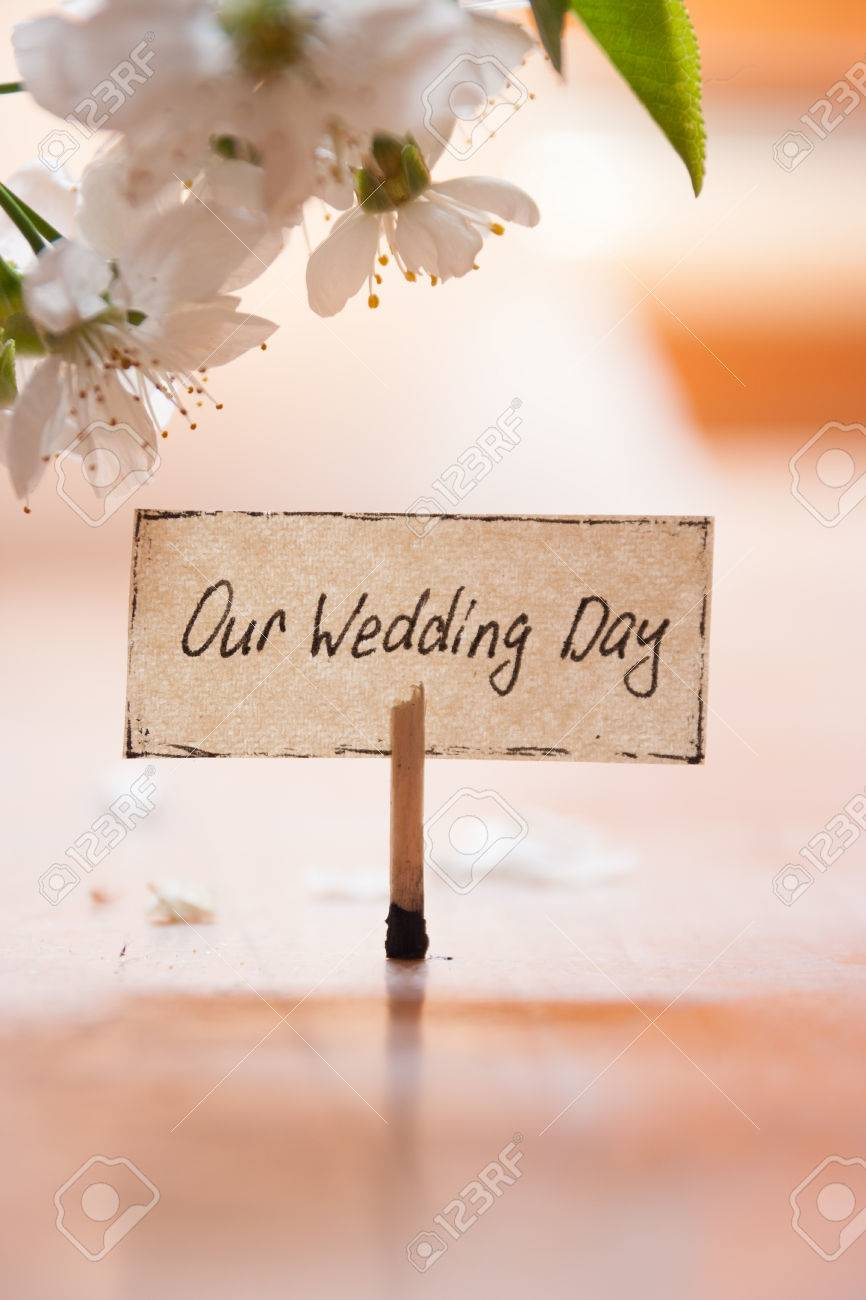 Our Wedding Day Concept, Lettering And White Flowers Background