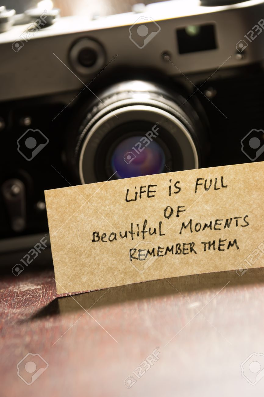 Photo Camera And Quote Life Is Full Of Beautiful Moments Remember