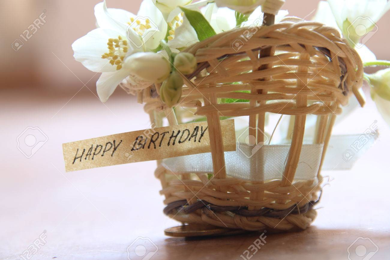 happy birthday letter tag or label a basket of flowers stock photo