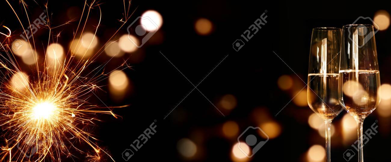sparkling new year background with two champagne glasses stock photo 63841702