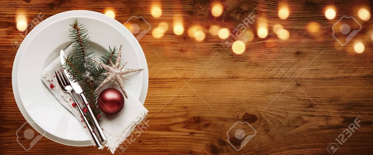 rustic christmas table decoration on old wood with bokeh effect
