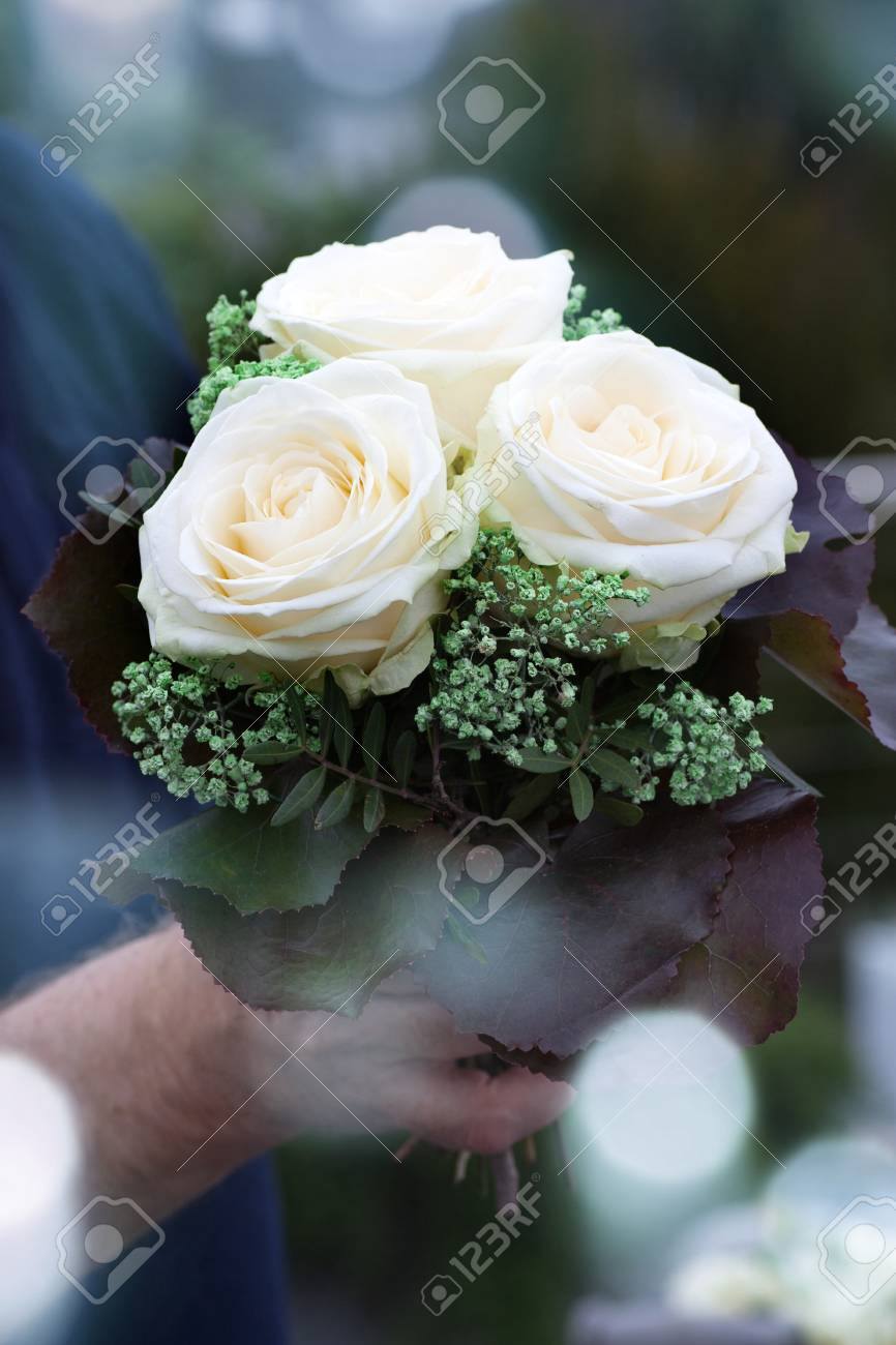 Wedding Bouquet With White Roses And Bokeh For The Bride Stock Photo