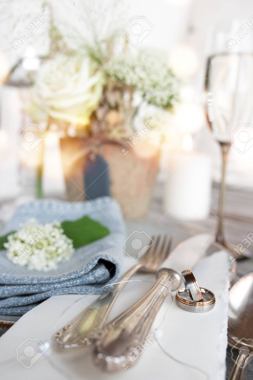 Wedding Rings On A Table Decoration In Vintage Style Vertical