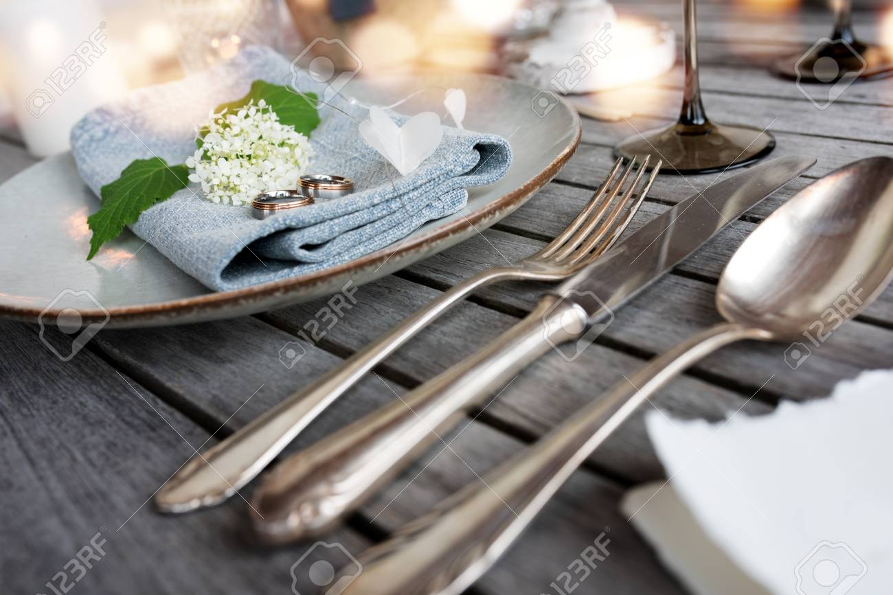 Wedding Rings On A Table Decoration In Vintage Style With Golden