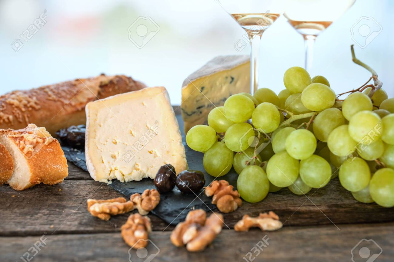 Cheese dekoration on rustic wooden table. Food photography with short depth of field and space for text for gastronomy concepts. Close-up. - 148353456