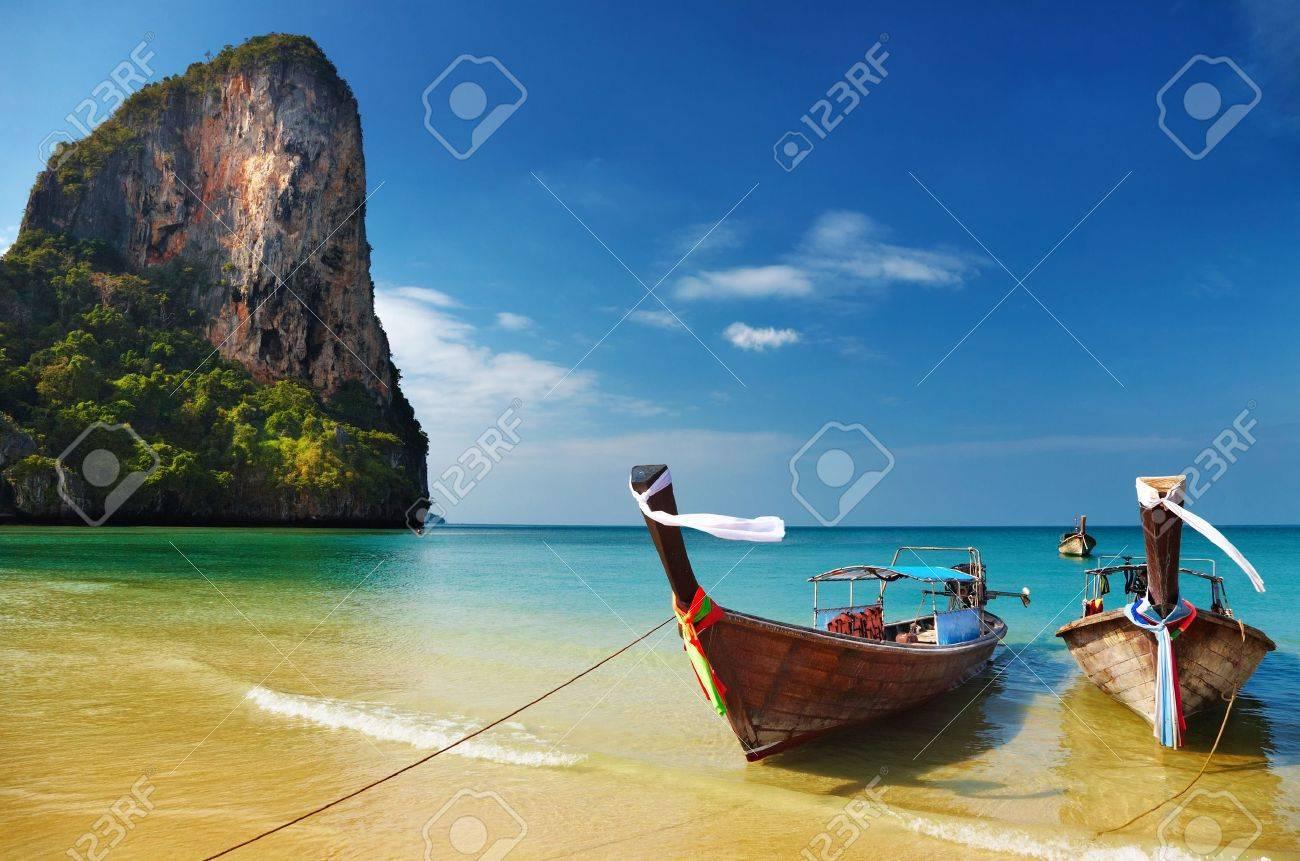 Tropical beach, traditional long tail boats, Andaman Sea, Thailand Stock Photo - 7153689