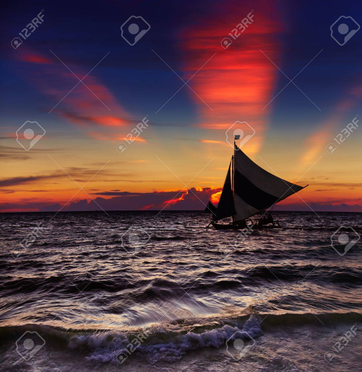 Tropical sunset with sailboat, Boracay, Philippines - 18366278