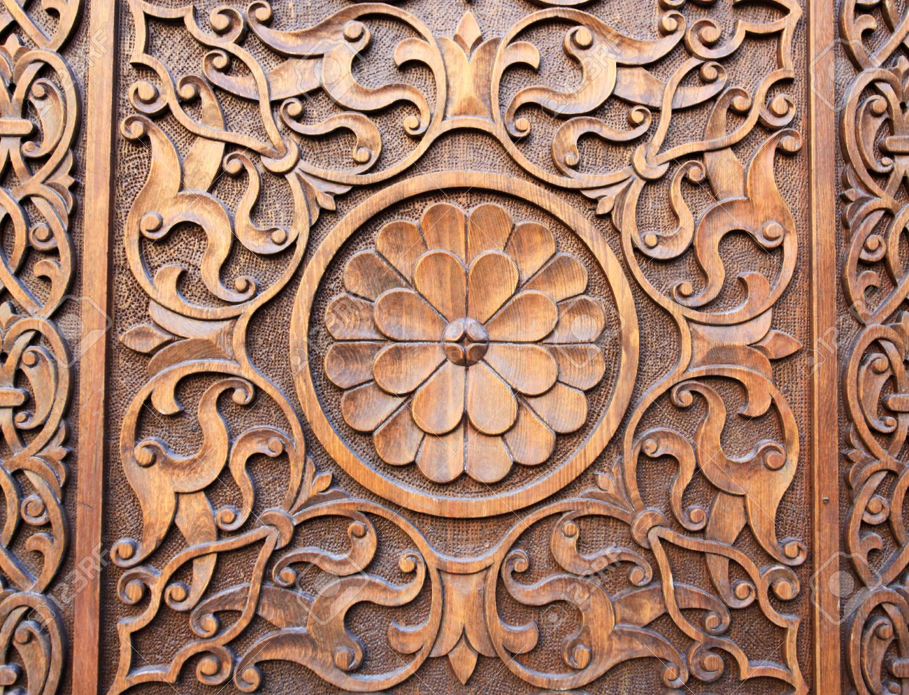 Islamic Persian design consisting stars and flowers carved on the surface of an old wooden & Islamic Persian Design Consisting Stars And Flowers Carved On ...