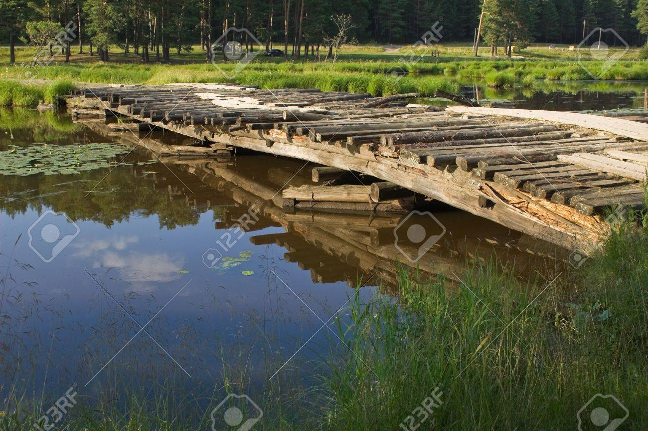 View on log bridge over small river Stock Photo - 3988299