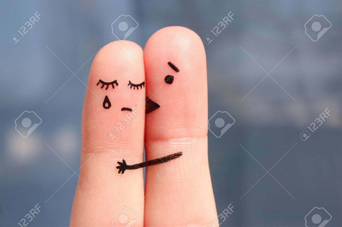 Finger art of displeased couple. Woman cries, man reassures her. He kisses and hugs her. - 56859490