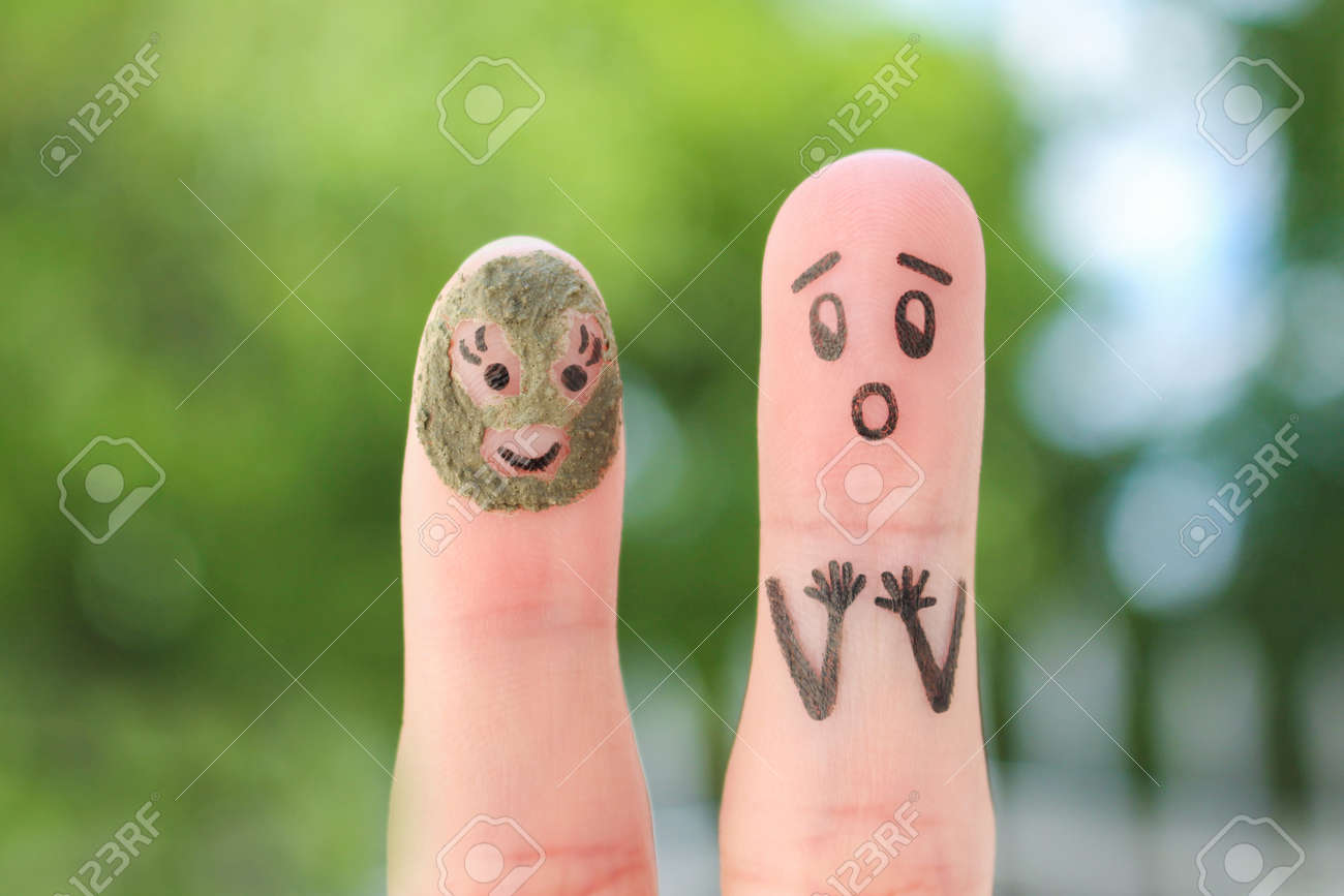 Fingers art of couple. Husband saw his wife with clay face mask and was afraid. - 155777721