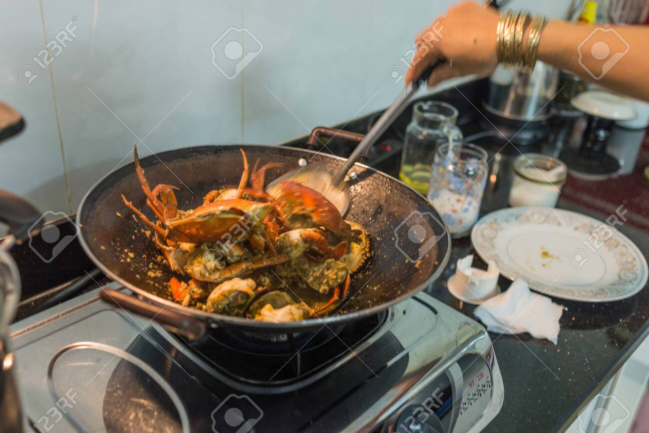 Woman Hand Using Paddle While Frying Chilly Crab In Kitchen Stock Photo Picture And Royalty Free Image Image 130325197