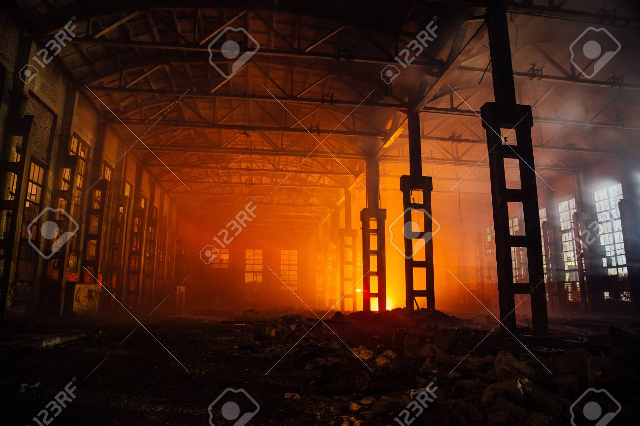 Fire in the factory. Burned by fire industrial building. - 91735784