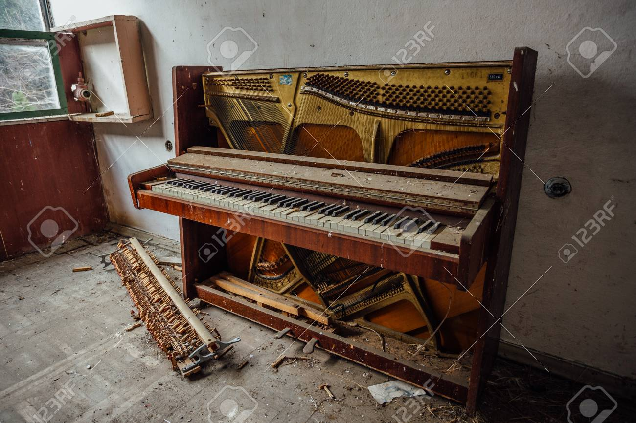 Old ruined piano in abandoned house