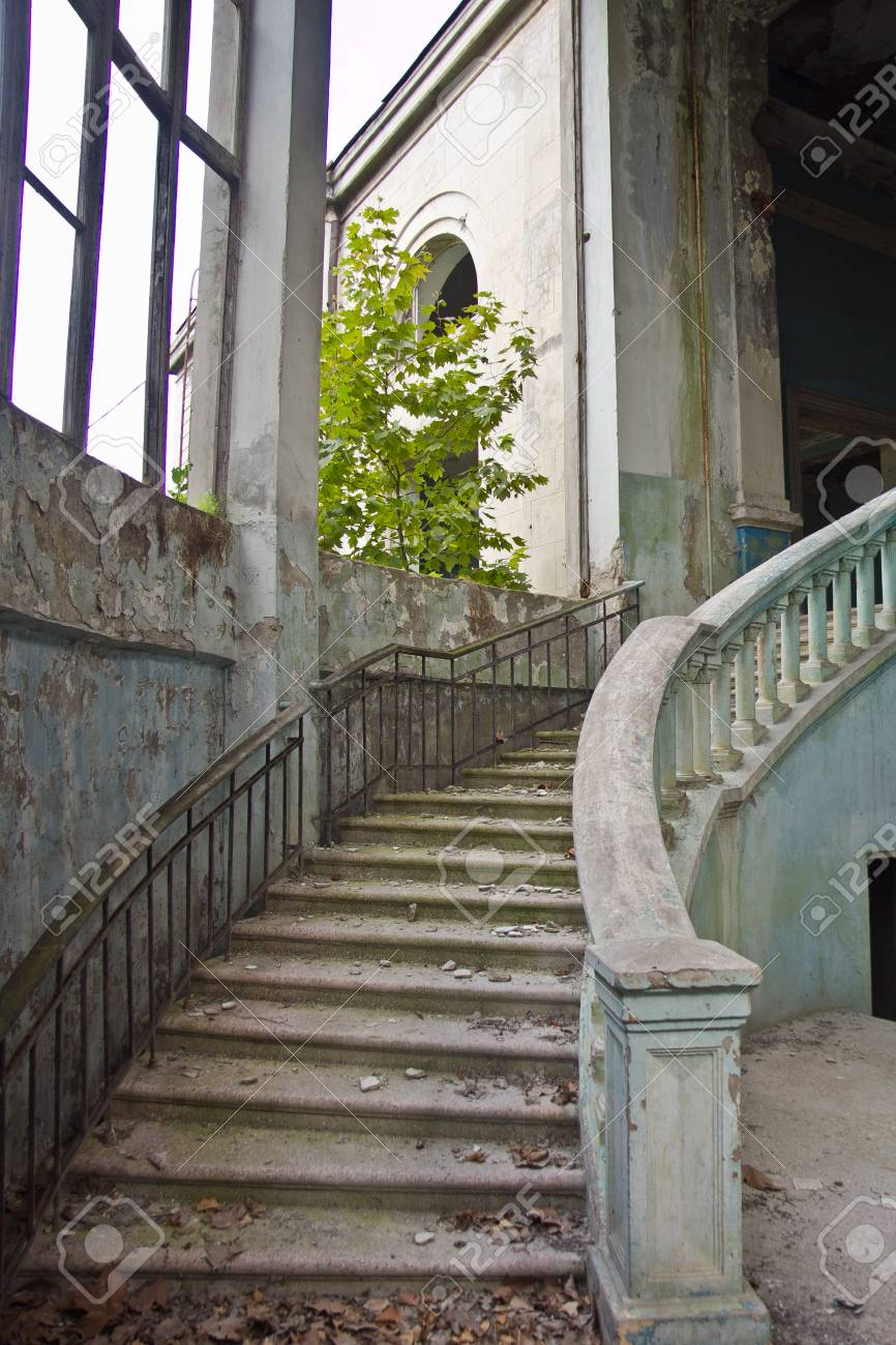 Old Vintage Marble Spiral Staircase At Abandoned Overgrown Mansion
