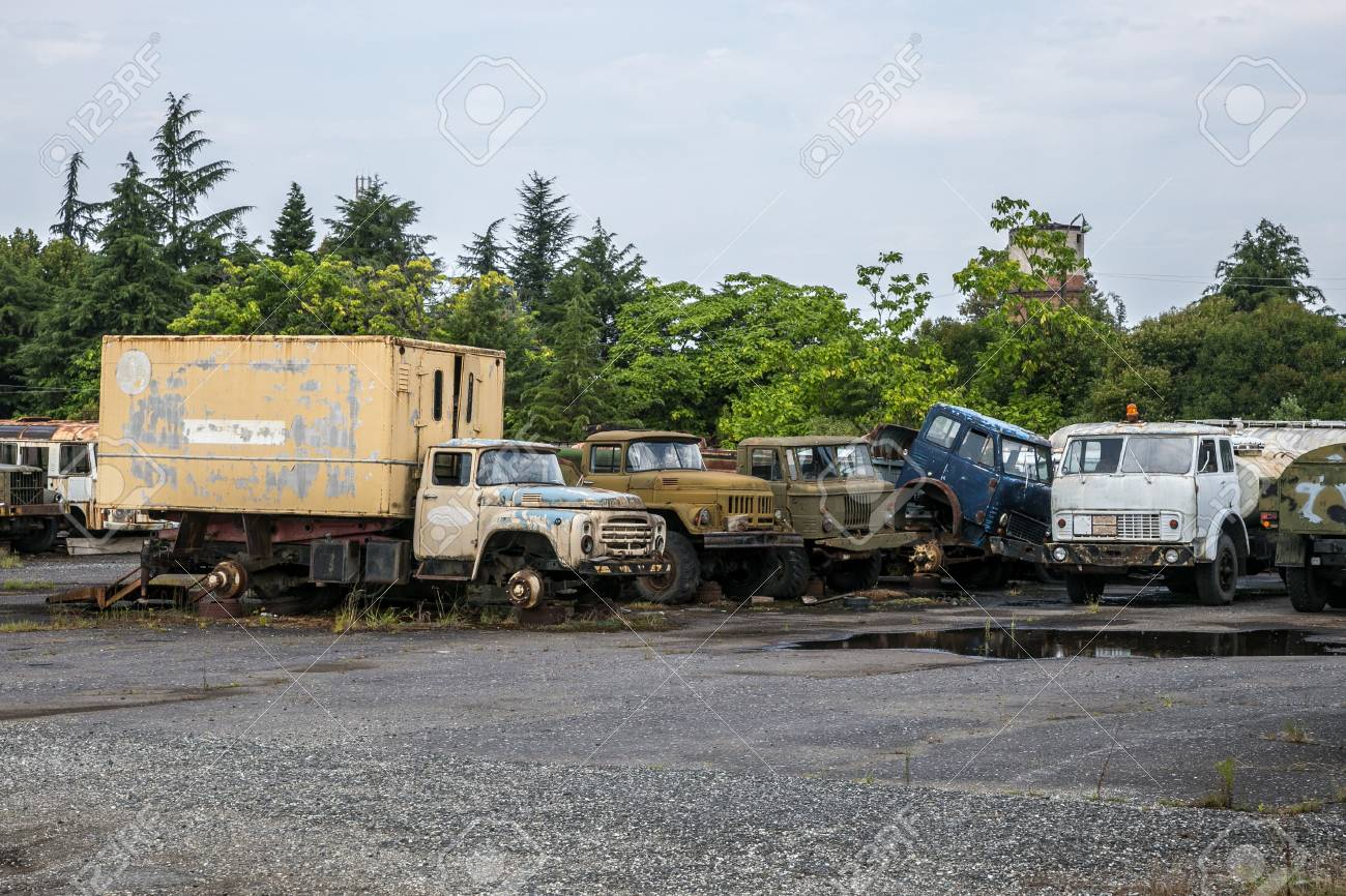 Old Rusty Trucks At Abandoned Industrial Area. Rusty Trucks Junkyard ...