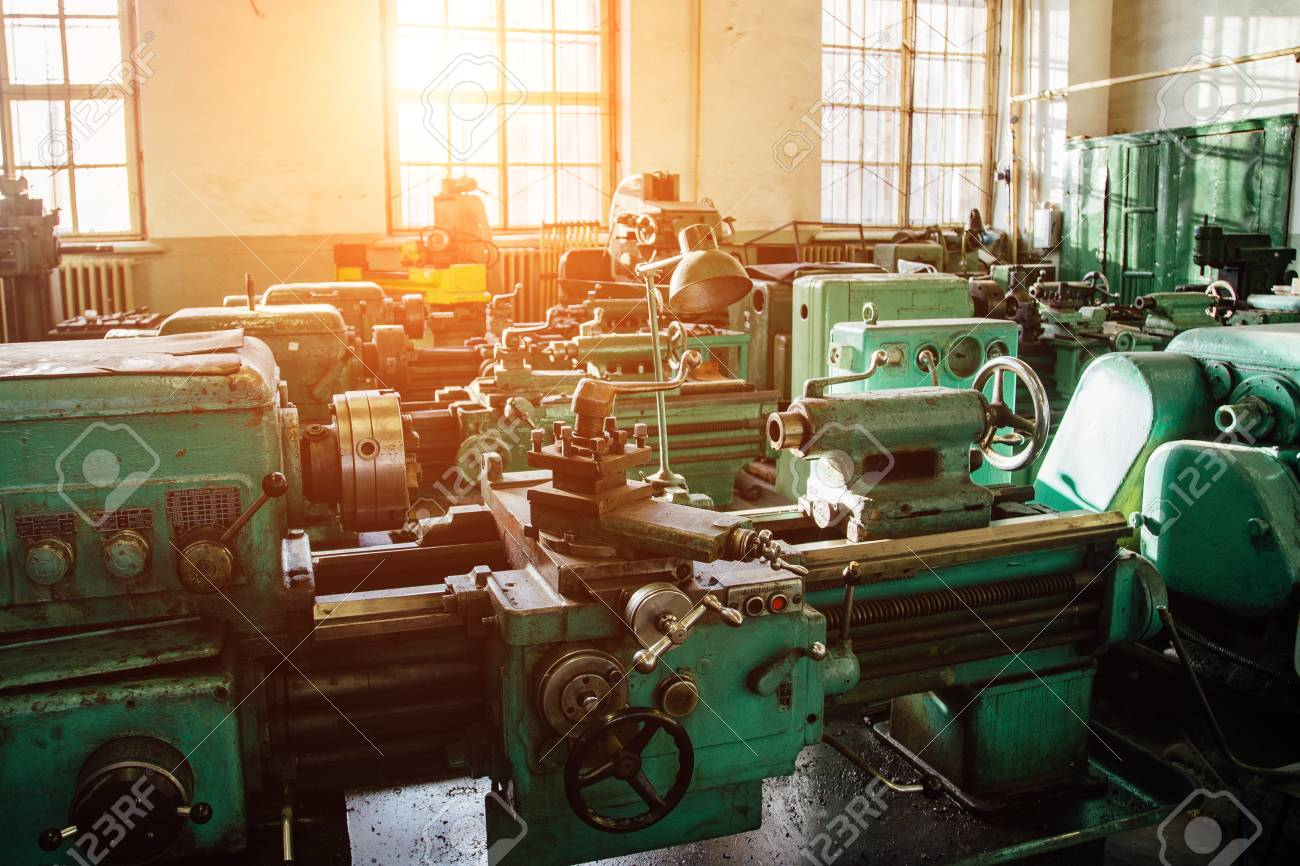 Industrial turning and drilling machine tools in old workshop