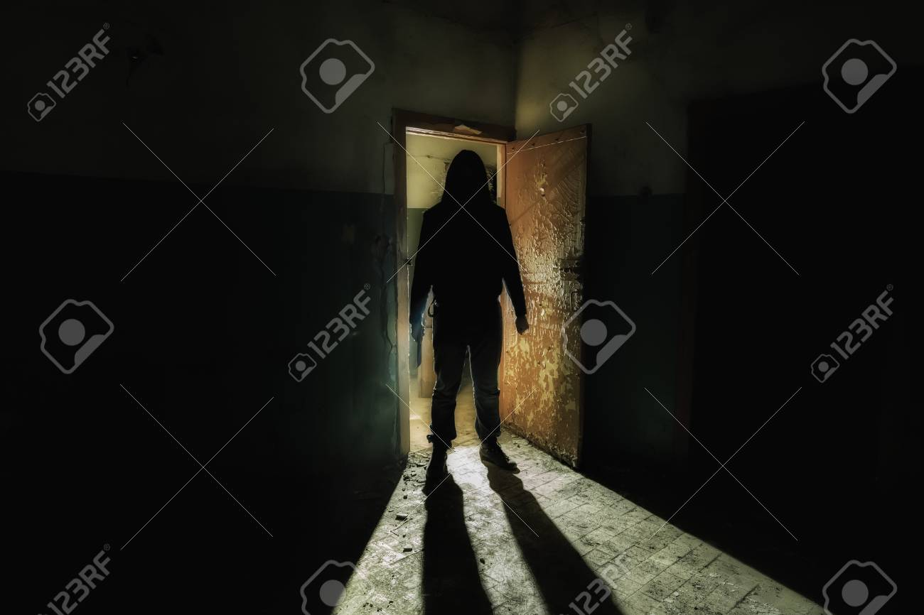 Creepy Silhouette Of Unknown Man With Knife In Dark Abandoned Stock Photo Picture And Royalty Free Image Image 113096938