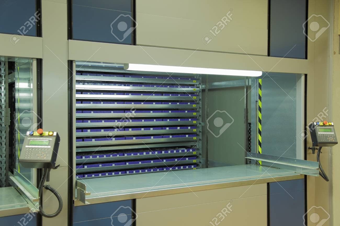 Ordinaire Automated Storage System In The Warehouse.Vertical Carousel Storage Unit  Stock Photo   85311002