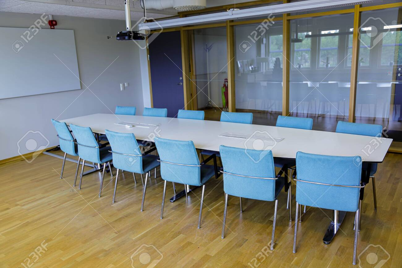 Long White Office Table With Twelve Blue Chairs In The Meeting Stock Photo Picture And Royalty Free Image Image 127103848