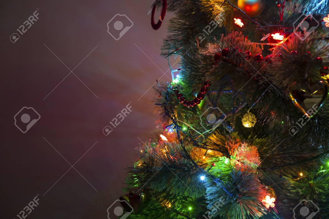 Beautiful Christmas Tree With Multi Colored Lights On Dark