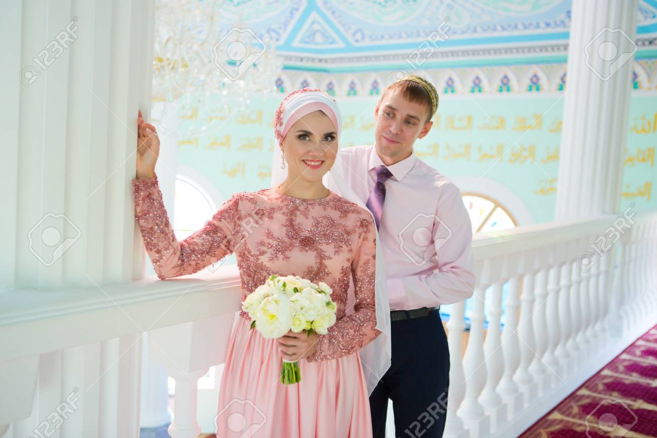Islamic couple in a mosque on a wedding ceremony muslim marriage islamic couple in a mosque on a wedding ceremony muslim marriage stock photo junglespirit Images