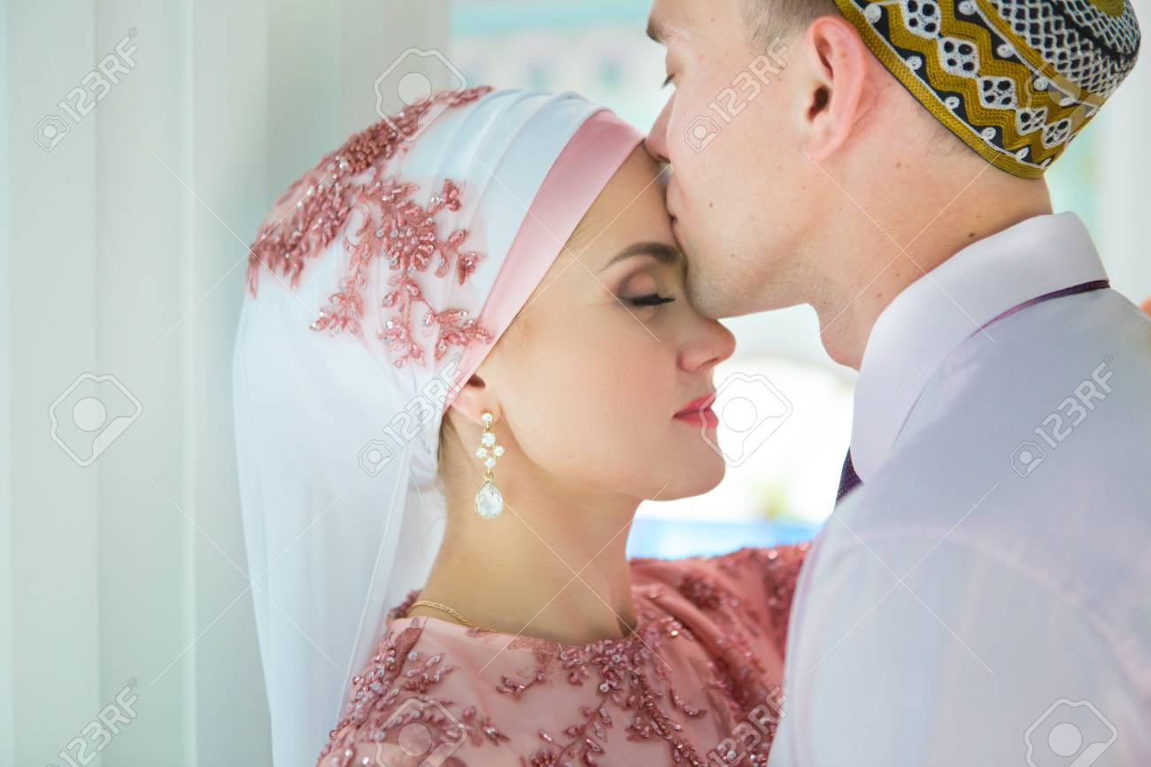 Islamic couple in a mosque on a wedding ceremony  Muslim marriage