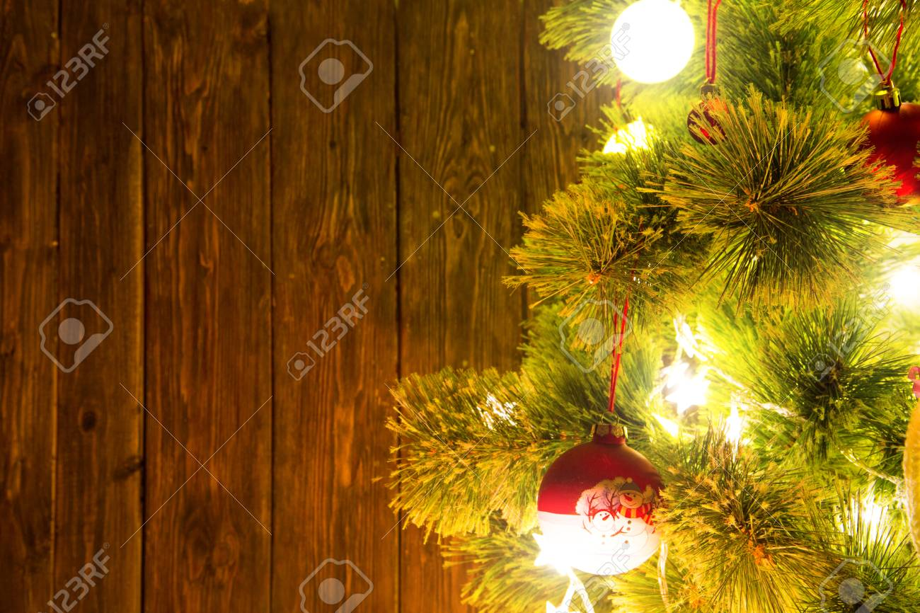 Decorated Christmas Tree With Christmas Lights And Balls On Wooden ...