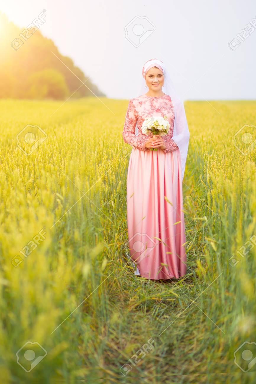 Muslim bride posing at a celebration ceremony on the field  Muslim