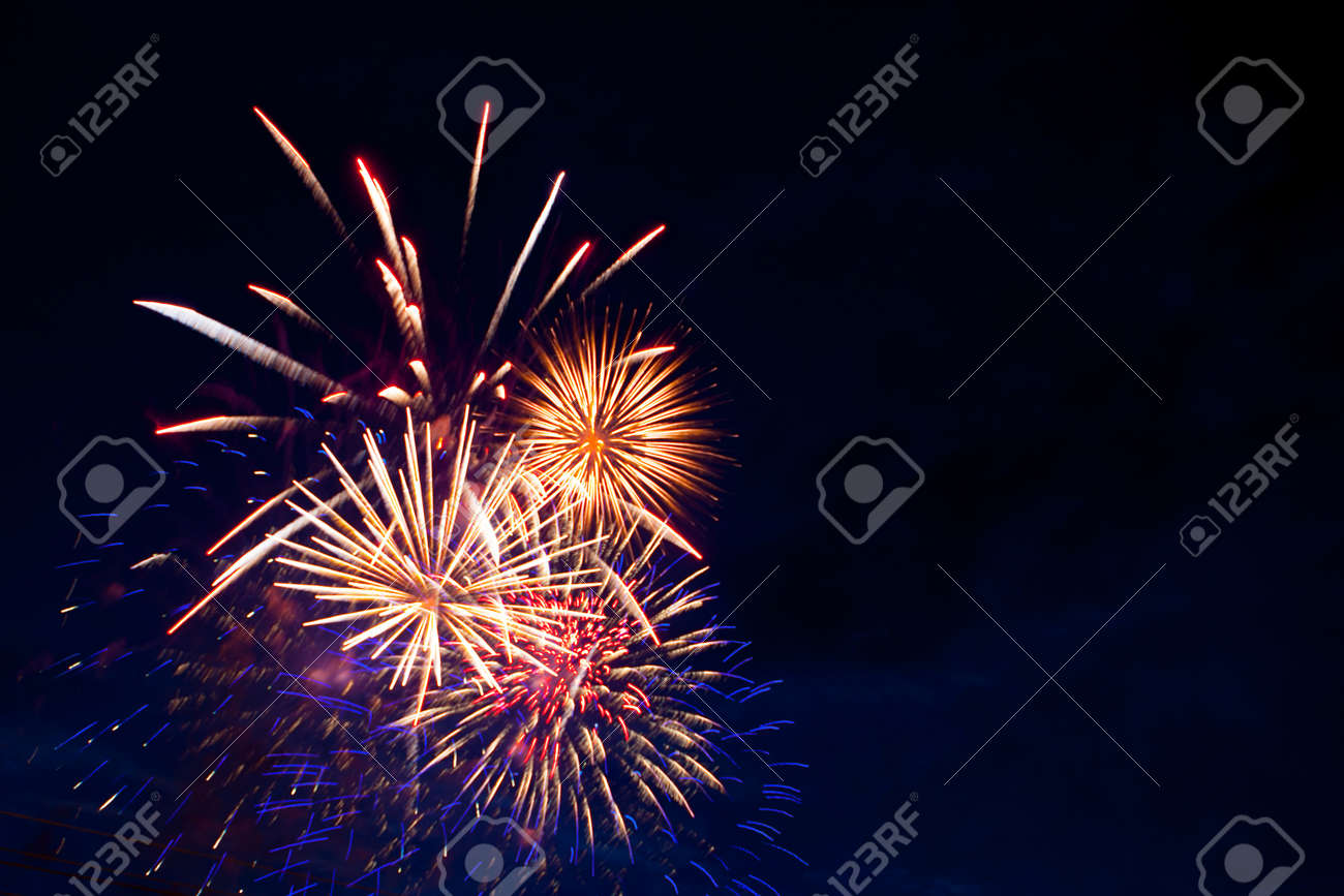 Fireworks on the background of the dark night sky. 4th July - American Independence Day - 169182275