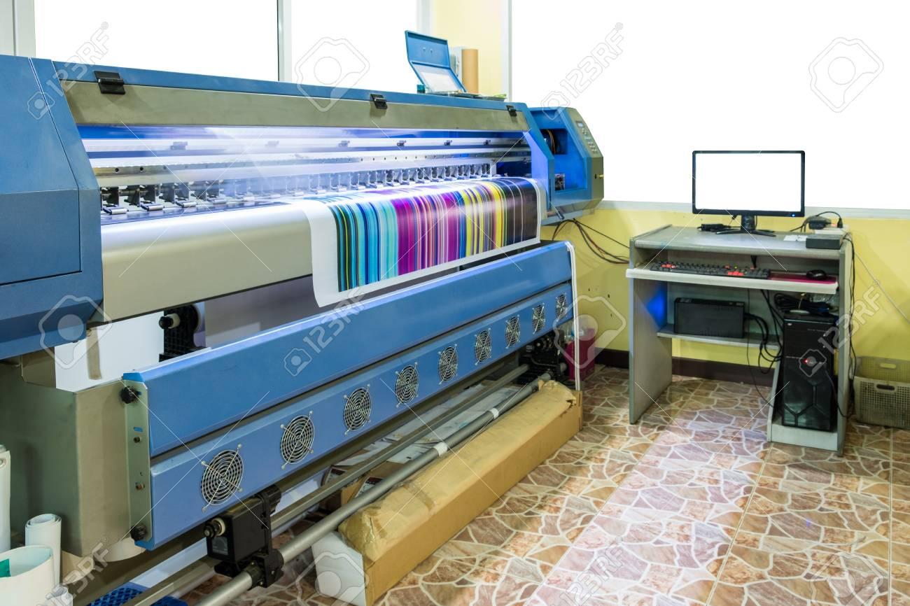 photo relating to Printable Vinyl Inkjet Printers named Hefty inkjet printer doing work multicolor cmyk upon vinyl banner..
