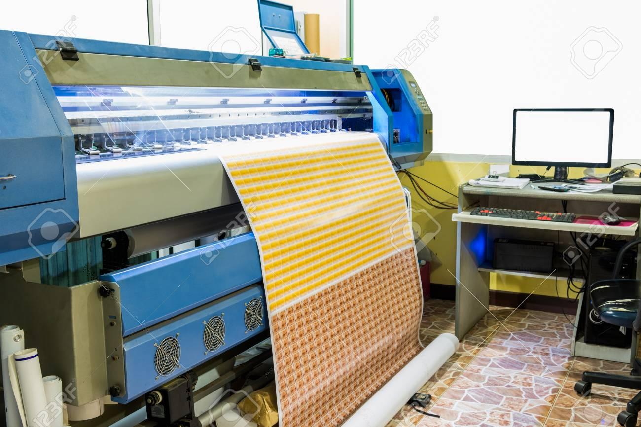 Large inkjet printer working sticker business card with computer large inkjet printer working sticker business card with computer control in printing plant stock photo colourmoves