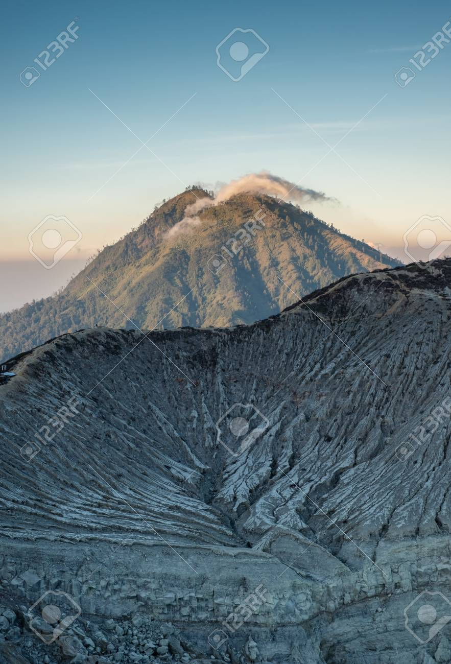 8355497a6 Cloud on mountain with crater textured on Kawah Ijen at morning Stock Photo  - 112631822