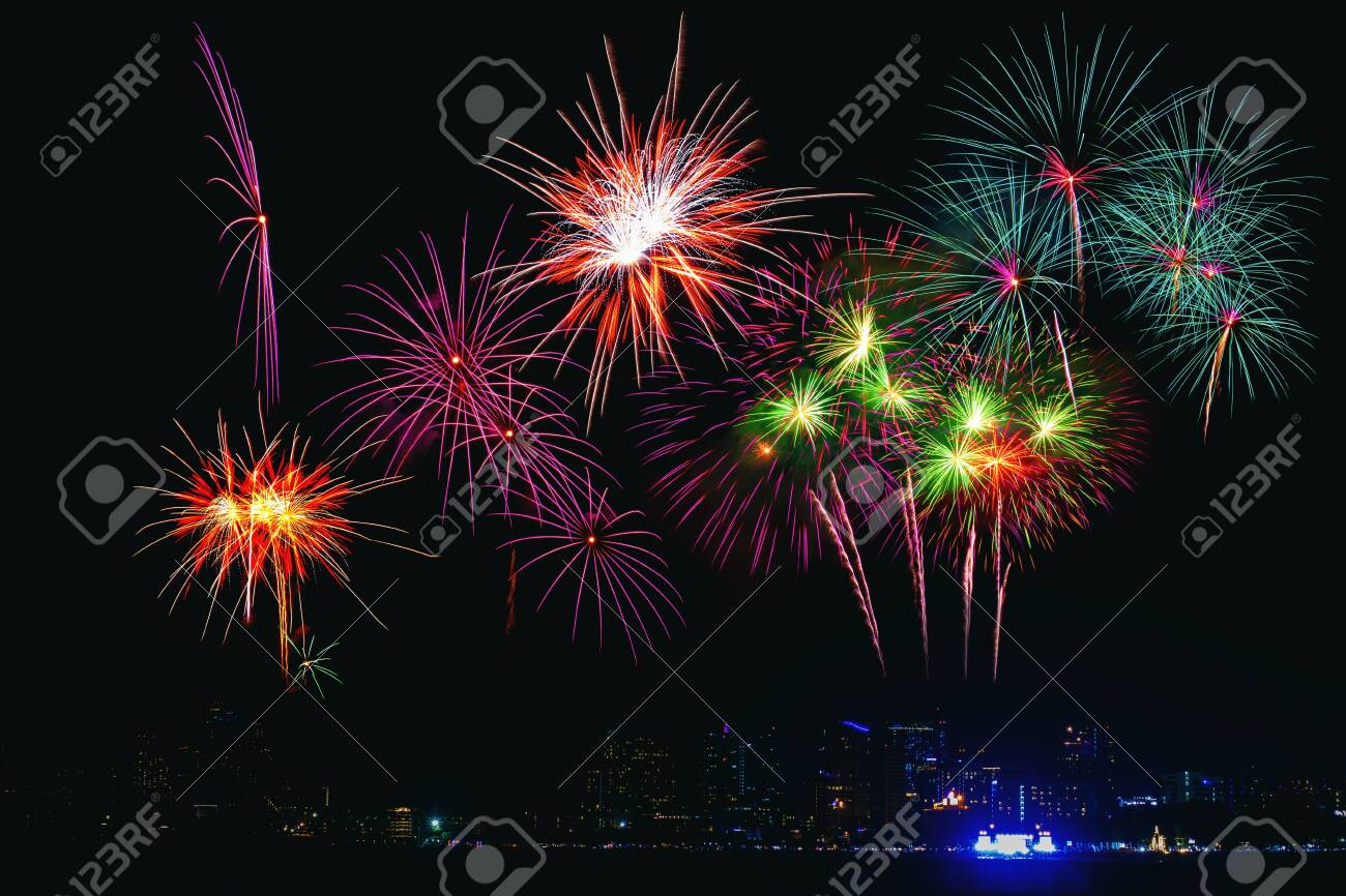 Beautiful colorful fireworks display on the sea beach, Amazing holiday fireworks party or any celebration event in the dark sky. - 126021039