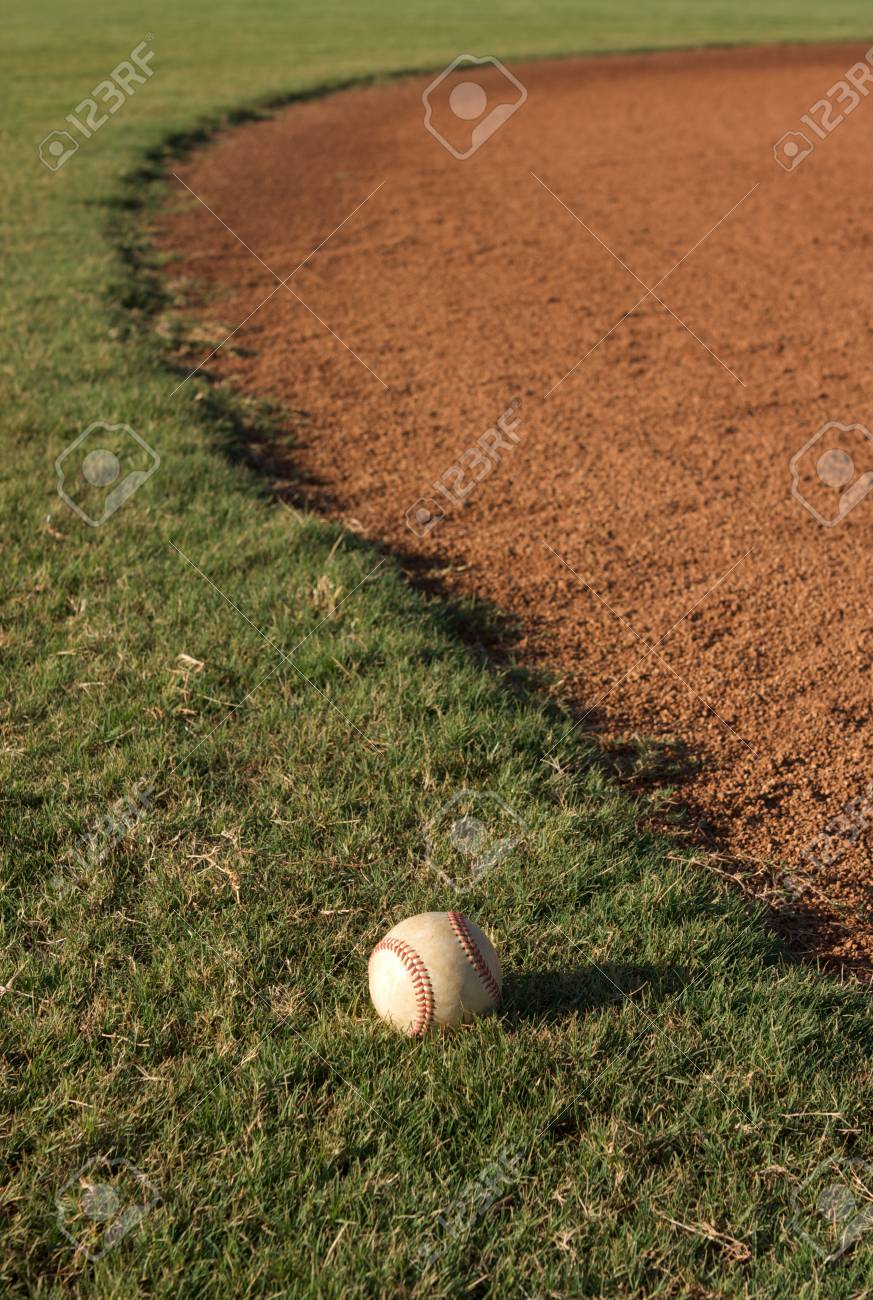 Baseball on the fringe of the Outfield Stock Photo - 23726771