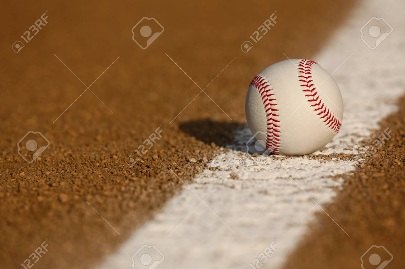 Baseball on the Infield Chalk Line with room for copy Stock Photo - 26508071