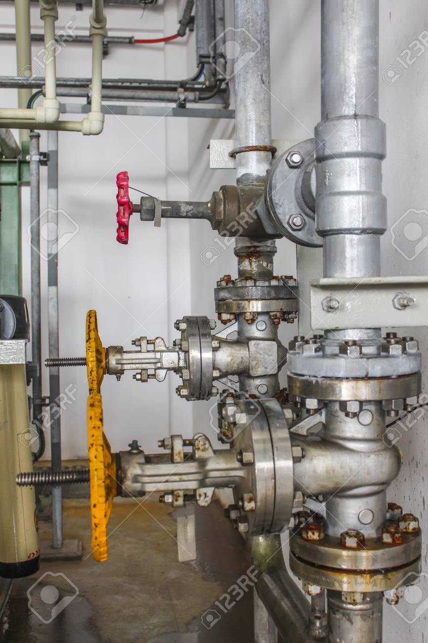 Yellow valve with steel pipe line Stock Photo - 15434064