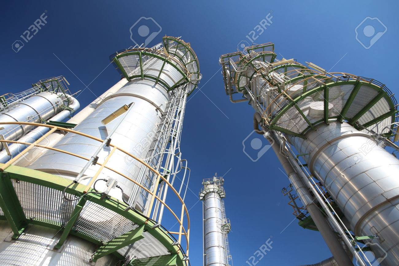 Refinery tower in petrochemical plant with blue sky - 26860719