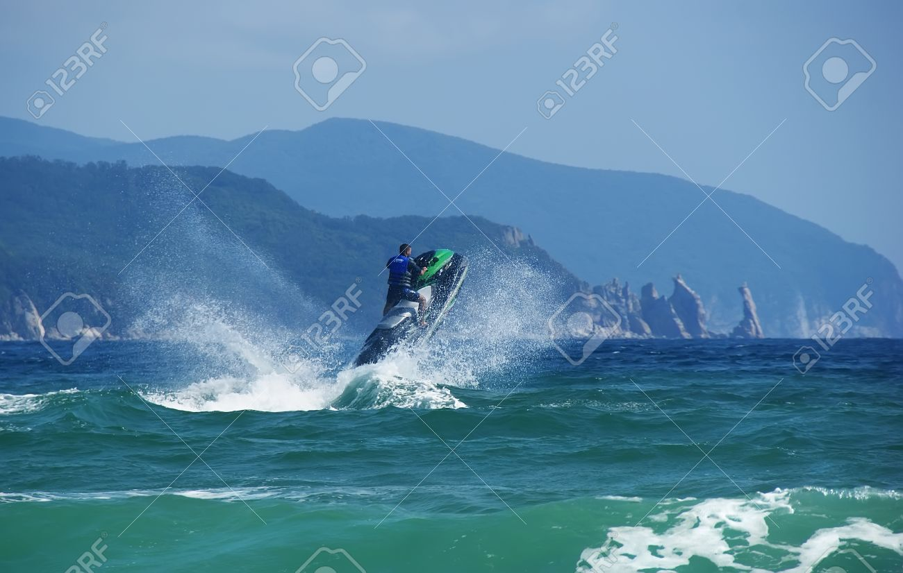 Jump on a water bike in a very beautiful landscape. Stock Photo - 16542334