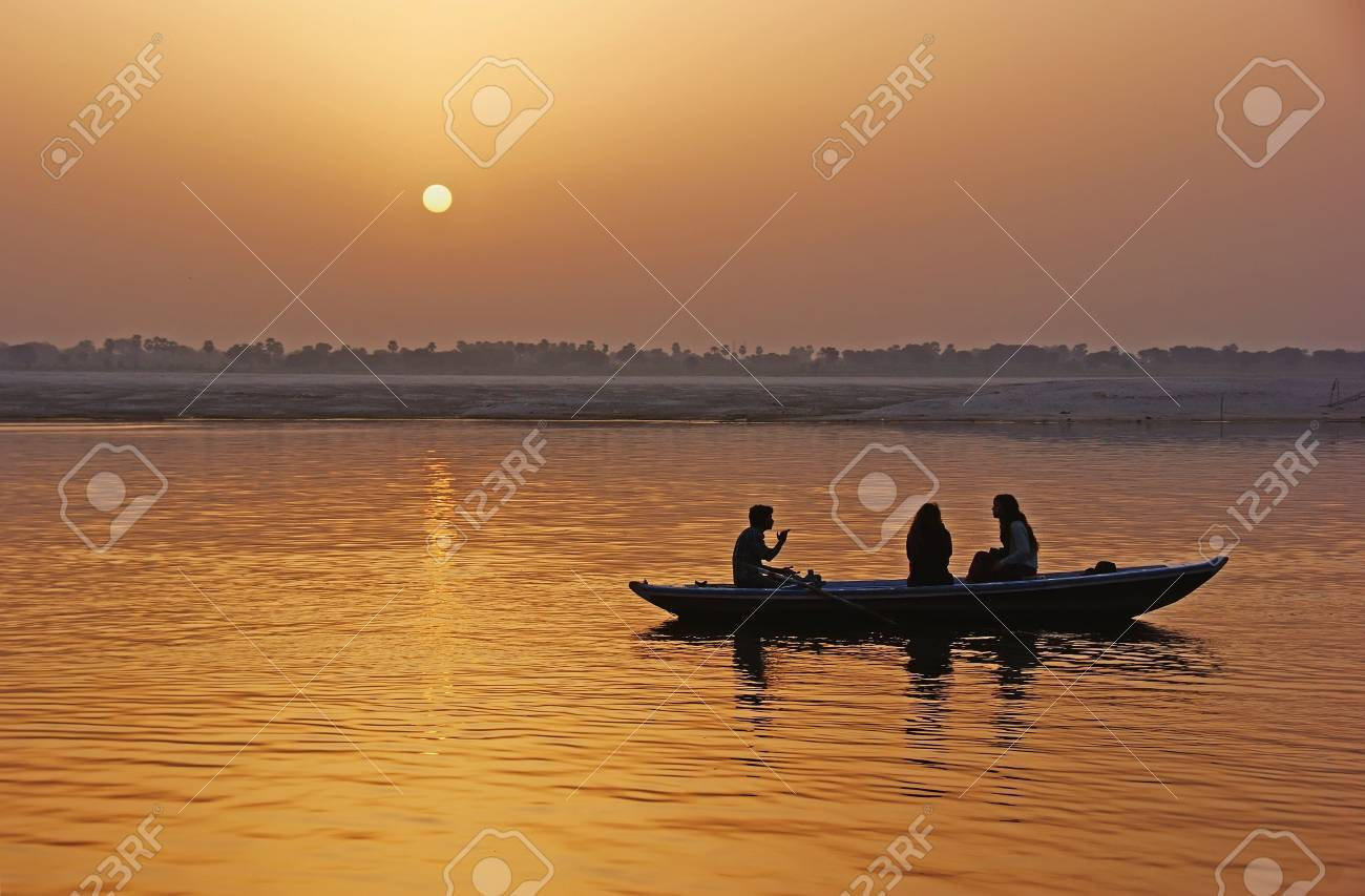 The boat with the people on the river at sunset. Stock Photo - 16542326